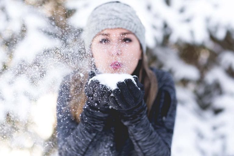 girl blowing snowball