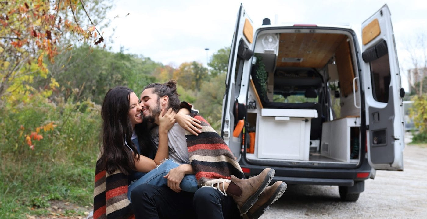 couple kissing in front of RV