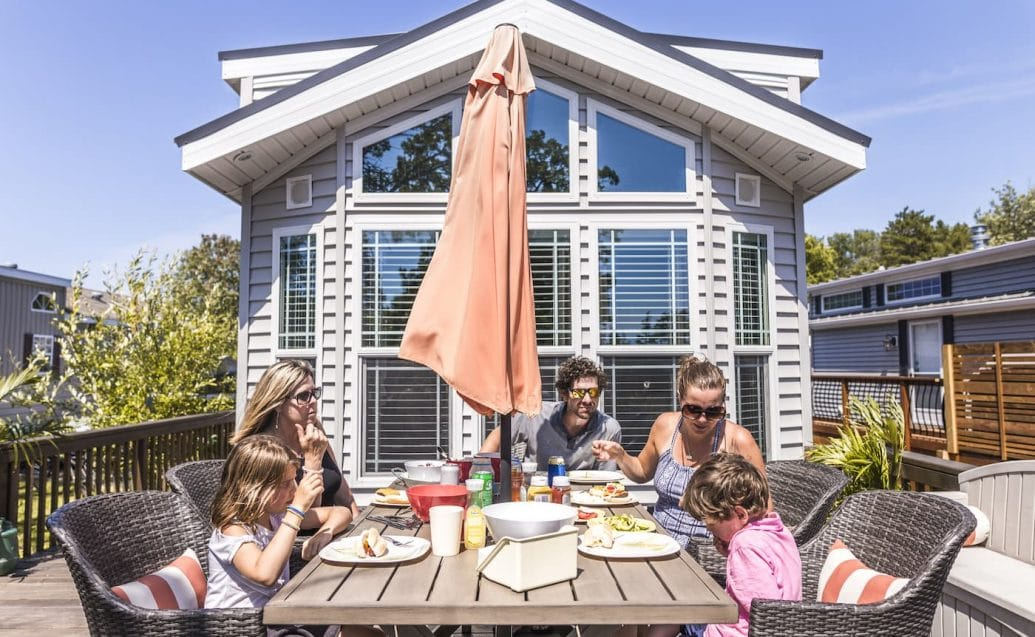 Family eating by park model