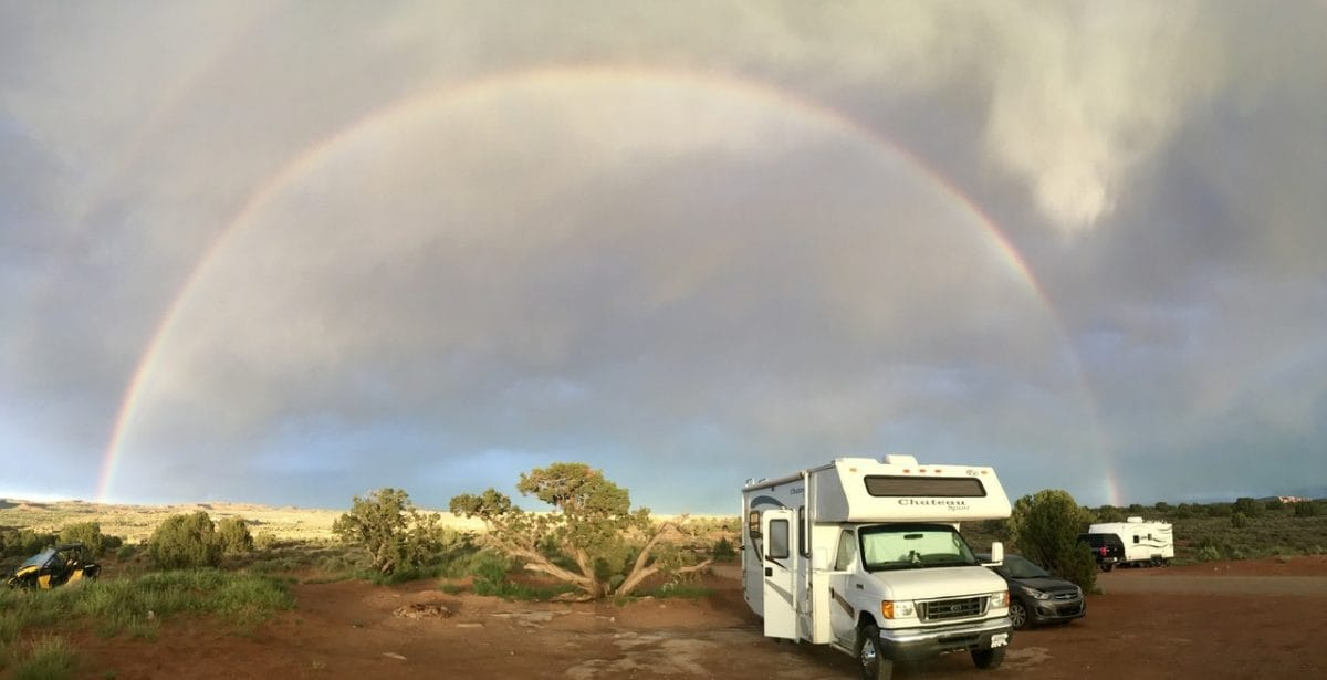 RV in front of a rainbow