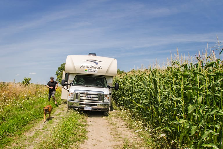 RV by person with dog