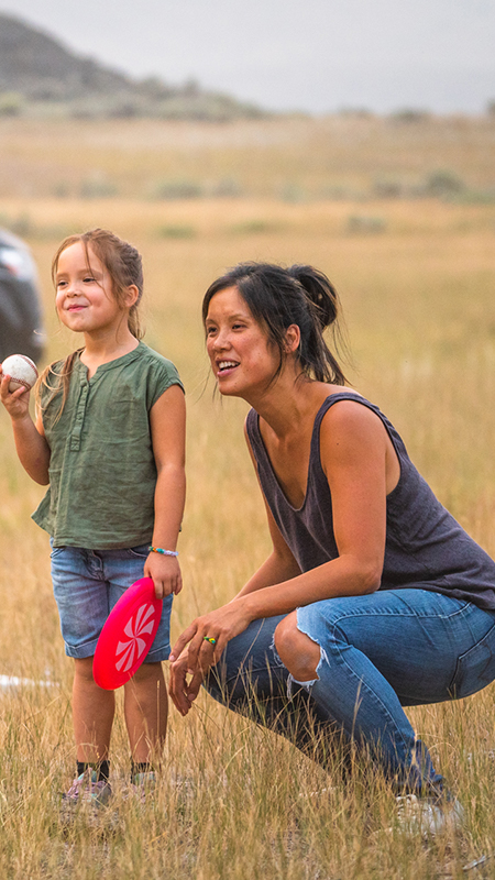 child and mother with baseball
